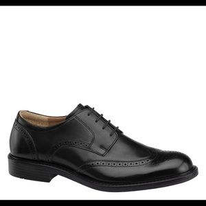 Johnston and Murphy black wingtip shoes.
